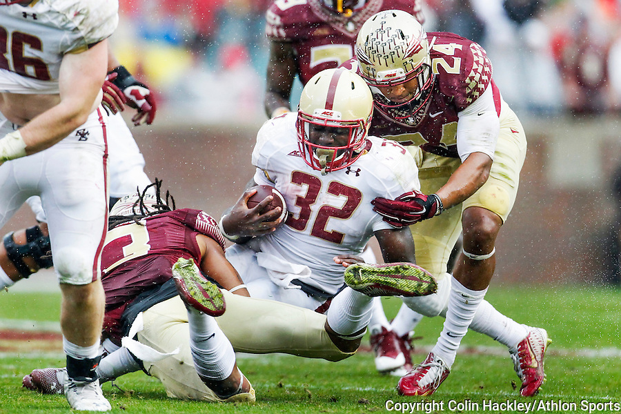 Florida State University Seminoles Ronald Darby, left, and Terrance Smith stop Boston College Eagles Jon Hilliman during the football game in Tallahassee, Florida on November 22, 2014. Green left the field after this play but returned later in the first half.<br /> Colin Hackley/Athlon Sports