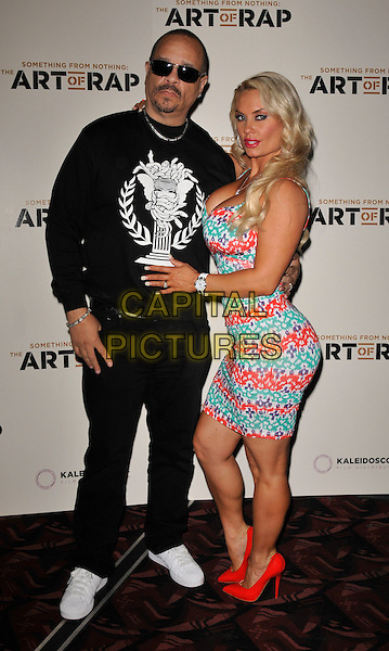 Ice T (Tracy Marrow) & Coco Austin.'Something For Nothing: The Art of Rap' European premiere arrivals, Hammersmith Apollo, London, England. 19th July 2012..full length red green white print dress married couple husband wife black jumper sweatshirt trousers sunglasses white trainers .CAP/WIZ.© Wizard/Capital Pictures.