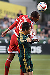Jun 6, 2015; Portland, OR, USA; New England Revolution forward Teal Bunbury (10) and Portland Timbers defender Jorge Villafana (19) go up for a ball during the first half of the game at Providence Park. Mandatory Credit: Steve Dykes-USA TODAY Sports