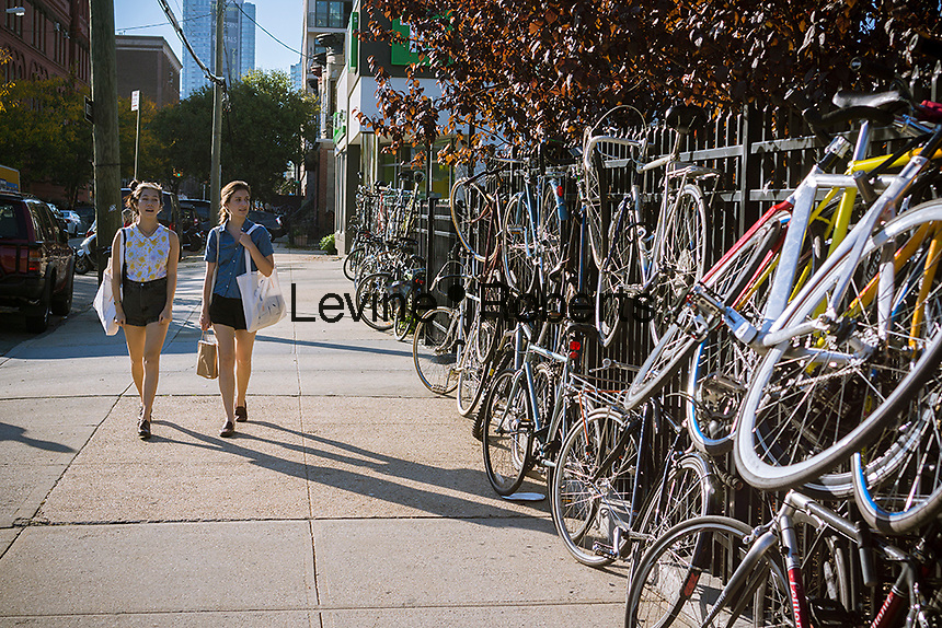 Bicyclists park their bikes where they can outside of MoMA PS1 in Long Island City in New York on Saturday, September 27, 2014.   (© Richard B. Levine)