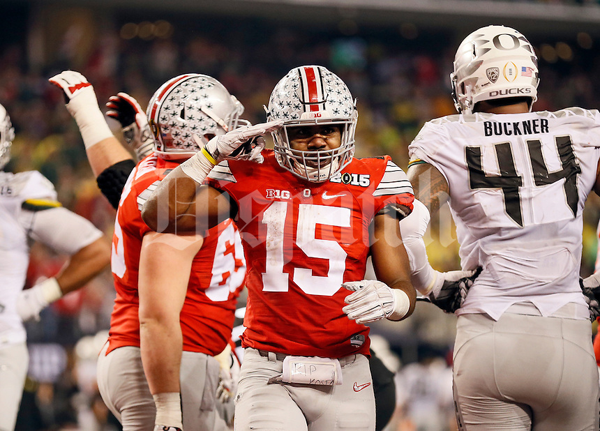 Ohio State Buckeyes quarterback Cardale Jones (12) salutes the crowd after scoring a touchdown during the 4th quarter of their 42-20 win over Oregon in the College Football Playoff National Championship at AT&T Stadium in Arlington, Texas on Jan. 12, 2015. (Adam Cairns / The Columbus Dispatch)