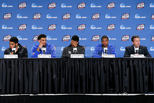 Center Karl-Anthony Towns, center Willie Cauley-Stein and guard Andrew Harrison accompanied by Head coach John Calipari of the Kentucky Wildcats talk during their post game press conference during the Final Four of the 2015 NCAA Men's Basketball Tournament at Lucas Oil Stadium on Saturday, April 4, 2015 in Indianapolis, In.  Photo by Jonathan Krueger | Staff.