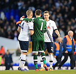 Tottenham's Toby Alderweireld, Hugo Lloris and Kevin Wimmer celebrate at the final whistle during the Premier League match at White Hart Lane Stadium.  Photo credit should read: David Klein/Sportimage