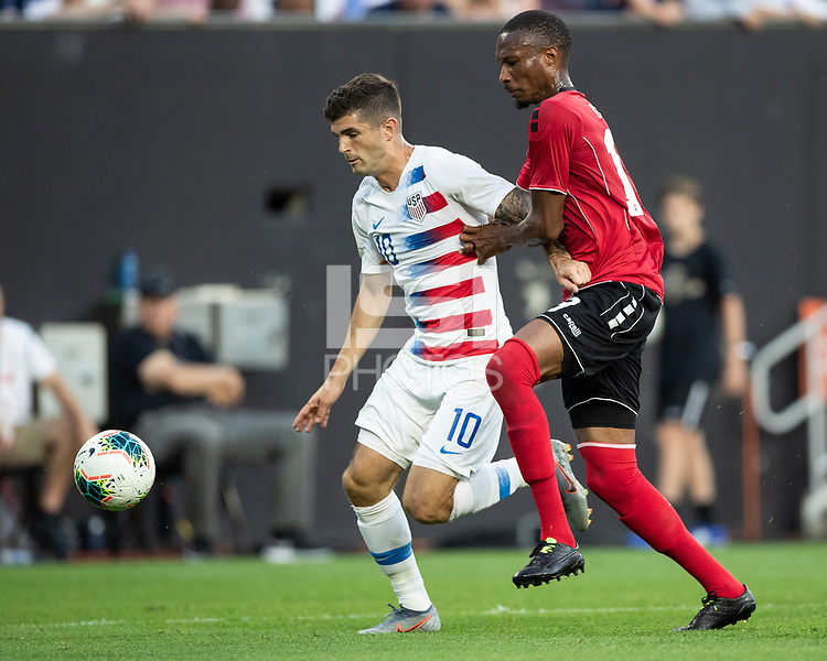 CLEVELAND, OH - JUNE 22: Christian Pulisic #10 and Kevan George #19 go for the ball during a game between the United States and Trinidad & Tobago at FirstEnergy Stadium on June 22, 2019 in Cleveland, Ohio.