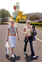 PHILADELPHIA, PA - JUNE 15:  Lauren Perry (L), and Nicole Watson (R) both of Philadelphia, Pennsylvania walk to their car carrying their packages after shopping at Franklin Mills Mall June 15, 2005 in Philadelphia, Pennsylvania. (Photo by William Thomas Cain)