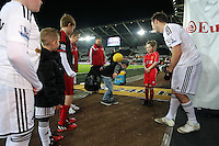 SWANSEA, WALES - MARCH 16: Young Swansea supporters are shown how to freestyle by Ash Randall<br />