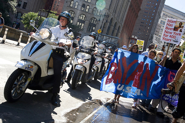 Police on motorcycles accompany participants in the Rally for Unity & Solidarity with Muslim People on 11 September 2010, in New York City, New York, the 9th anniversary of the attacks on the World Trade Center and Pentagon.  In the midst of controversy over a mosque being developed near Ground Zero, an emergency mobilization against racism and anti-islamic bigotry was held.