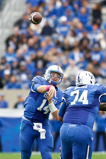 Kentucky quarterback Patrick Towles throws the ball down field during the second half of the Kentucky vs. University of Louisiana at Monroe football game at Commonwealth Stadium in Lexington, Ky., on Saturday, October 11, 2014. UK won 48-14 over ULM. Photo by Jonathan Krueger | Staff