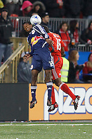 New York Red Bulls midfielder Danleigh Borman (12) and Toronto FC defender Marvell Wynne (16) go up for a header. Toronto FC and the New York Red Bulls played to a 1-1 tie during a Major League Soccer match at BMO Field in Toronto, Ontario, Canada, on May 1, 2008.