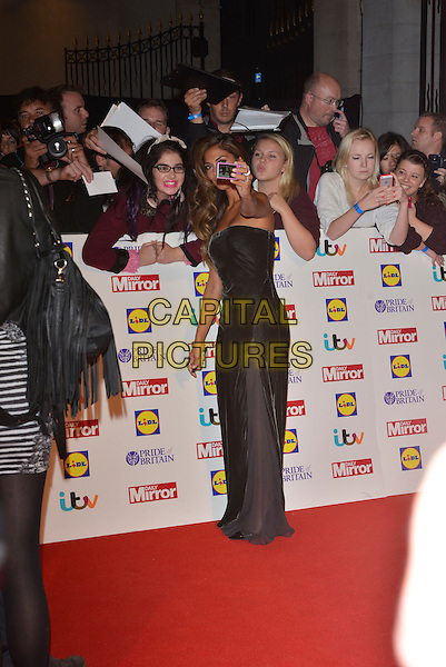 Nicole Scherzinger<br /> The Daily Mirror's Pride of Britain Awards arrivals at the Grosvenor House Hotel, London, England.<br /> 7th October 2013<br /> full length dress black strapless sheer side fans crowd taking picture photograph <br /> CAP/PL<br /> &copy;Phil Loftus/Capital Pictures