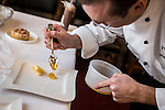 Executive chef Shannon Shaffer drizzles honey, which will be served with Hudson Valley apple pie, sour cream ice cream, and aged cheese for the inaugural lunch, on Friday, January 4, 2013 in Washington, DC.