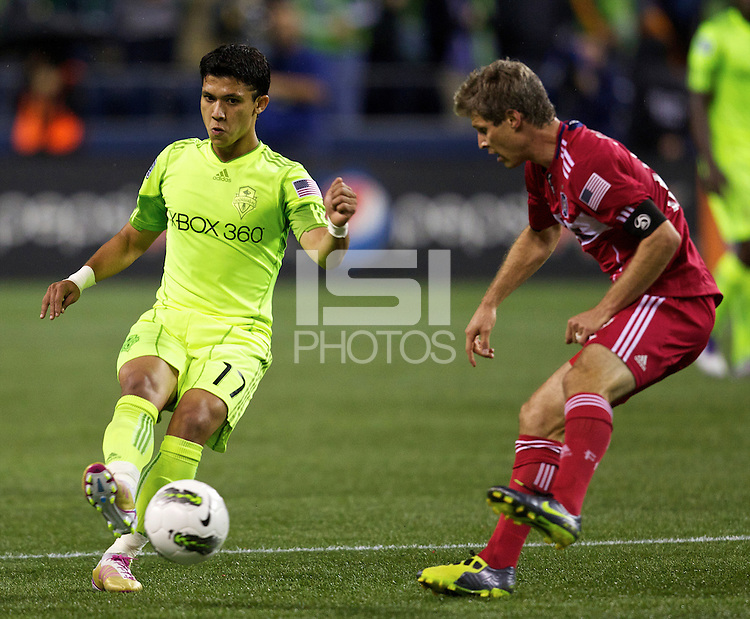Seattle Sounders FC forward Fredy Montero, left, passes the ball as Chicago Fire midfielder Logan Pause defends during play between the Seattle Sounders FC and the Chicago Fire in the U.S. Open Cup Final at CenturyLink Field in Seattle Tuesday October 4, 2011. Seattle won the game 2-0 to win its third U.S. Open Cup.