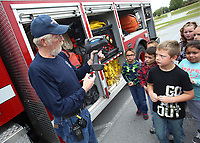 NWA Democrat-Gazette/DAVID GOTTSCHALK  Gary Hull, Chief of the Nob Hill Fire Department, describes the uses for a thermal imaging camera Wednesday, October 11, 2017, to second grade students in Jessica Breshears' class at Sonora Elementary School. Hull, Tyler McCartney, assistant fire marshal with the Washington County Sheriff's Office and Will Hewat (cq), assisting (cq) the Washington County Sheriff's Office Fire Mashall Division, were visiting the school promoting Fire Prevention Week and teaching children fire prevention and safety. The students participated in a virtual fire safety drill, experienced the Fire Prevention and Life Safety Trailer and toured the Nob Hill Fire Department Heavy Rescue unit.
