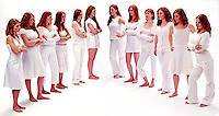 Group of red haired women facing each other<br />