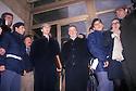 Sergio Cusani (center with hat), a former advisor to Raul Gardiini, with his lawyer, Giuliano Spazzali, pose for photographers at the exit of Courthouse, Milan January 1994. Cusani is charged with false accounting and illegally financing of political parties. © Carlo Cerchioli..Sergio Cusani (al centro con il cappello), ex consulente di Raul Gardini, con il suo avvocato Giuliano Spazzali, posa per i fotografi all'uscita dal palazzo di Giustizia, Milano, gennaio 1994. Cusani è imputato di falso in bilancio e finanziamento illecito ai partiti.