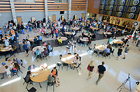 NWA Democrat-Gazette/CHARLIE KAIJO Students and parents pick up school IDs, fill out paperwork and visit vendors during a school open house, Thursday, August 1, 2018 at Bentonville High School in Bentonville. <br />