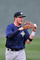 First baseman Dash Winningham (34) of the Columbia Fireflies warms up before a game against the Greenville Drive on Thursday, April 21, 2016, at Fluor Field at the West End in Greenville, South Carolina. Columbia won, 13-9. (Tom Priddy/Four Seam Images)