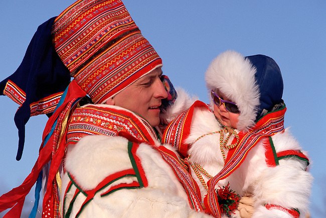 Sami father & son, both wearing best traditional clothes. Kautokeino, Norway