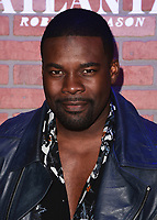 "LOS ANGELES - FEBRUARY 19:  Amin Joseph at the red carpet event for FX's ""Atlanta Robbin' Season"" at the Ace Theatre on February 19, 2018 in Los Angeles, California.(Photo by Scott Kirkland/FX/PictureGroup)"
