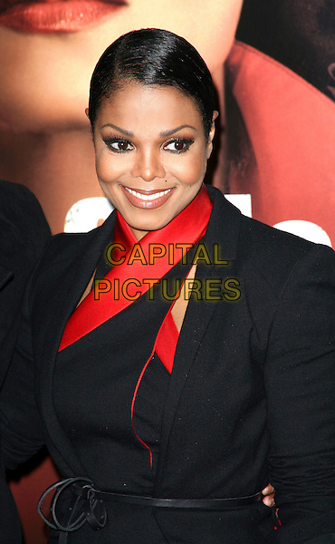 JANET JACKSON .The New York Special Screening of 'For Colored Girls' at Ziegfeld Theatre in New York City,  New York, NY, USA, .25th October 2010..half length  black red smiling halterneck dress jacket belt make-up hair up .CAP/ADM/PZ.©Paul Zimmerman/AdMedia/Capital Pictures.
