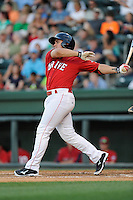 Infielder Michael Chavis (11) of the Greenville Drive bats in a game against the Charleston RiverDogs on Saturday, May 23, 2015, at Fluor Field at the West End in Greenville, South Carolina. Chavis was a first-round pick of the Boston Red Sox in the 2014 First-Year Player Draft. Charleston won 5-4. (Tom Priddy/Four Seam Images)