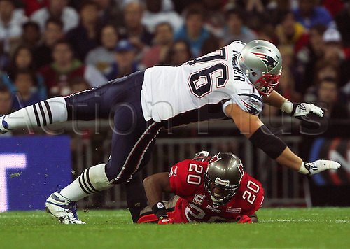 25th October 2009. Sebastian Vollmer stops the Buccaneers Ronde Barber in his tracks during the first half. NFL International Series. Tampa Bay Buccaneers v New England Patriots at Wembley Stadium, London, England. .Photo: Colin Read/actionplus.