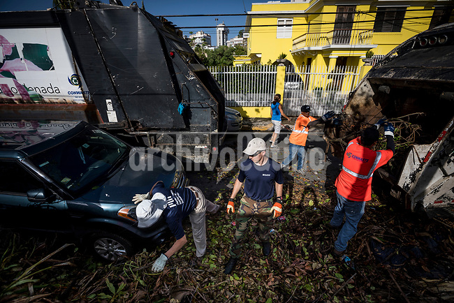 Massachussets Instute of Technology volunteers set up solar cells in a roof during the storm Mari aftermath in Loiza, Puerto Rico, where rescue teams are working to stand up basic infrastructure.
