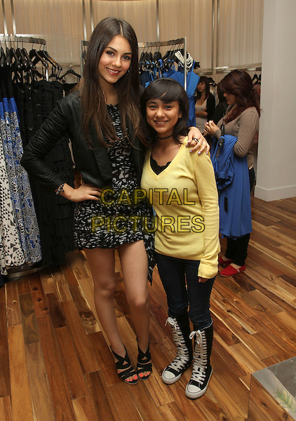 VICTORIA JUSTICE & FAN.BCBG  MaxAzria Introduces Prom Contest Hosted by Victoria Justice Held At BCBG MaxAzria Westfield Mall, Century City, California, USA, .18th April 2011..full length black jacket sandals print dress hand on hip arm around .CAP/ADM/KB.©Kevan Brooks/AdMedia/Capital Pictures.