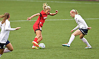 Portland, Oregon - Saturday May 21, 2016: The Portland Thorn's Long, Allie (10) and Washington Spirit's Megan Oyster (4) during a regular season NWSL match at Providence Park.