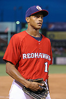 Justin Maxwell (16) of the Oklahoma City RedHawks heads to the dugout during the Pacific Coast League game against the Round Rock Express at Chickashaw Bricktown Ballpark on June 14, 2013 in Oklahoma City ,Oklahoma.  (William Purnell/Four Seam Images)