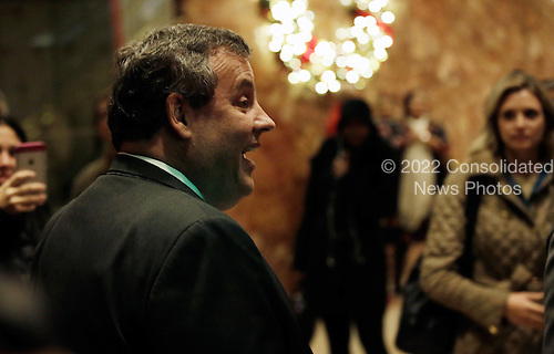Governor Chris Christie (Republican of New Jersey) walks through the lobby of Trump Tower USA, 02 December 2016.<br /> Credit: Justin Lane / Pool via CNP