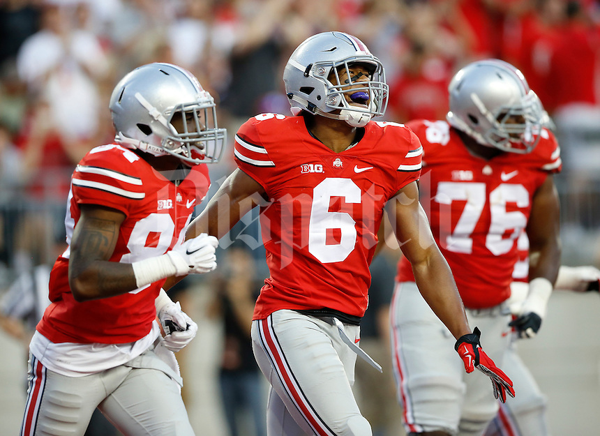 Ohio State Buckeyes wide receiver Evan Spencer (6) celebrates scoring a touchdown with teammates wide receiver Corey Smith (84) and offensive linesman Darryl Baldwin (76) during the second quarter of the NCAA football game at Ohio Stadium in Columbus on Sept. 27, 2014. (Adam Cairns / The Columbus Dispatch)
