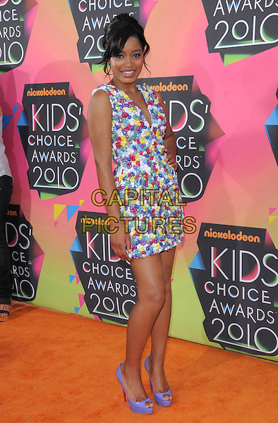 KEKE PALMER .at the 23rd Annual Nickelodeon Kids' Choice Awards 2010 held at Pauley Pavilion in Westwood, California, USA,.March 27th 2010                                                                                       .arrivals kids full length purple patent christian louboutin shoes peep toe platform sleeveless white green red yellow print patterned dress hand on hip v-neck low cut .CAP/RKE/DVS.©DVS/RockinExposures/Capital Pictures