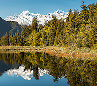 Mt. Tasman and  Aoraki, Mt. Cook of Southern Alps with reflections in Lake Matheson, Westland Tai Poutini National Park, West Coast, UNESCO World Heritage Area, South Westland, New Zealand, NZ