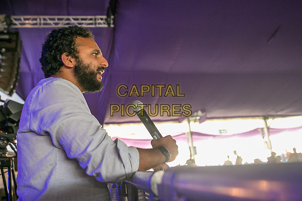 20th July 2014: English comedian Nish Kumar comperes the Comedy Arena on the fourth day of the 9th edition of the Latitude Festival, Henham Park, Suffolk.<br /> CAP/PP/HOG<br /> &copy; HOG/PP/Capital Pictures