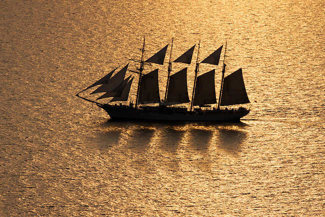 Tall ship Juan Sebastián de ElCano sailing at dusk