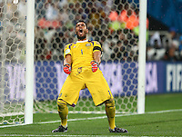 Argentina goalkeeper Sergio Romero celebrates saving the penalty of Wesley Sneijder of Netherlands during the penalty shoot out