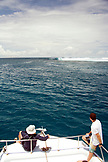 INDONESIA, Mentawai Islands, Kandui Resort,  watching surfers at Bankvaults from a boat