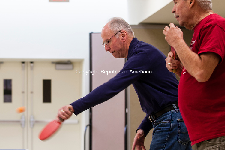 SOUTHBURY, CT-6 January 2015-010615EC01-  Will Casazza returns the serve next to his teammate, Dick Paltauf, as they play table tennis at the Southbury Senior Center Tuesday afternoon. Many of the Southbury seniors, including these men, practice seriously. They are preparing for the Connecticut Masters' Games in April. This year the annual Table Tennis Tournament is in Hartford. Players from all over the state will convene at the Pratt & Whitney gymnasium. Erin Covey Republican-American