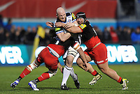 Matt Garvey of Bath Rugby is double-tackled by Jacques Burger and Titi Lamositele of Saracens. Aviva Premiership match, between Saracens and Bath Rugby on January 30, 2016 at Allianz Park in London, England. Photo by: Patrick Khachfe / Onside Images