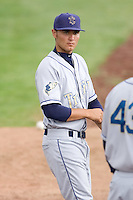 July 7, 2009: Tri-City Dust Devils pitcher Charles Ruiz hangs out in the bullpen prior to a Northwest League game against the Salem-Keizer Volcanoes at Volcanoes Stadium in Salem, Oregon.