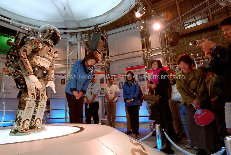 12/2/02--Yokohama, Japan..Honda's ASIMO robot bows to the public at a robot show in Japan...All photographs ©2003 Stuart Isett.All rights reserved.This image may not be reproduced without expressed written permission from Stuart Isett.