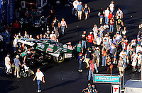 Sept. 14, 2012; Concord, NC, USA: NHRA fans surround the car of funny car driver John Force in the pits after a qualifying pass at the O'Reilly Auto Parts Nationals at zMax Dragway. Mandatory Credit: Mark J. Rebilas-