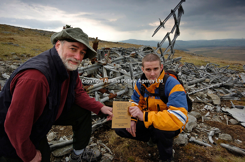 """Pictured L-R: Wes Cross from McGill University in Canada, Damien Thomas a local guide.<br /> Re: The nephew of a World War II airman whose plane crashed into a Welsh mountain has climbed the peak to pay tribute to the uncle he never met.<br /> Dr Peter Paré, 74, travelled from his home in Vancouver, Canada, to read a poem at the desolate spot where his uncle Bill Allison was killed.<br /> Flying officer Allison, 28, was one of the six crew of a Wellington Bomber that crashed on a training flight in November 1944.<br /> The plane wreckage is still scattered over Carreg Goch in the Brecon Beacons where hundreds of young airmen learned to prepare for bombing missions.<br /> Dr Paré said: """"I wanted to make this pilgrimage even though I was a baby when he died and never met Bill Allison.<br /> """"We only found out about the crash site recently and it is remarkable that so much of the plane is still here.""""<br /> Flying officer Allison was the oldest on board when the plane's starboard engine developed a fault during a low-flying exercise.<br /> For years local people have honoured the brave airmen by flying a Canadian flag at the scene - replacing it every time it gets ripped by strong winds.<br /> Dr Paré, retired Professor of Medicine at the University of British Columbia, said: """"It was very moving to see the Maple Leaf flying where my uncle died all those years ago.<br /> """"It brought a tear to my eye as I read the poem I wrote in his honour."""""""