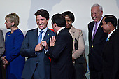 Justin Trudeau, Canada's prime minister, left, jokes with Matteo Renzi, Italy's prime minister, during a family photo at the Nuclear Security Summit in Washington, D.C., U.S., on Friday, April 1, 2016. After a spate of terrorist attacks from Europe to Africa, Obama is rallying international support during the summit for an effort to keep Islamic State and similar groups from obtaining nuclear material and other weapons of mass destruction. <br /> Credit: Andrew Harrer / Pool via CNP