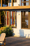 A dog looks longingly out the window of a contemporary island home.  This image is available through an alternate architectural stock image agency, Collinstock located here: http://www.collinstock.com