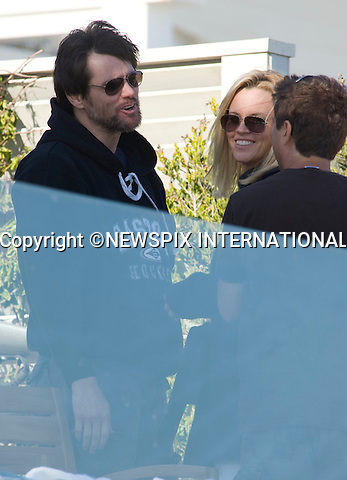 """JIM CARREY AND JENNY McCARTHY .celebrate Independence Day with Children, at Jim Carrey's Malibu beach house. Malibu_04/07/2009.Mandatory Photo Credit: ©Dias/Newspix International..**ALL FEES PAYABLE TO: """"NEWSPIX INTERNATIONAL""""**..PHOTO CREDIT MANDATORY!!: NEWSPIX INTERNATIONAL(Failure to credit will incur a surcharge of 100% of reproduction fees)..IMMEDIATE CONFIRMATION OF USAGE REQUIRED:.Newspix International, 31 Chinnery Hill, Bishop's Stortford, ENGLAND CM23 3PS.Tel:+441279 324672  ; Fax: +441279656877.Mobile:  0777568 1153.e-mail: info@newspixinternational.co.uk"""
