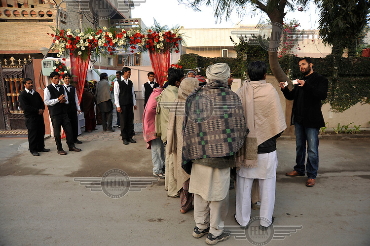 A gang of professional beggars outside the wedding ceremony of British/Punjabi couple Lindsay and Navneet Singh at a gurdwara in Amritsar.