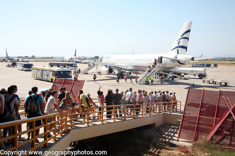 Passengers waiting to board Thomas Cook charter plane Rhodes airport, Greece