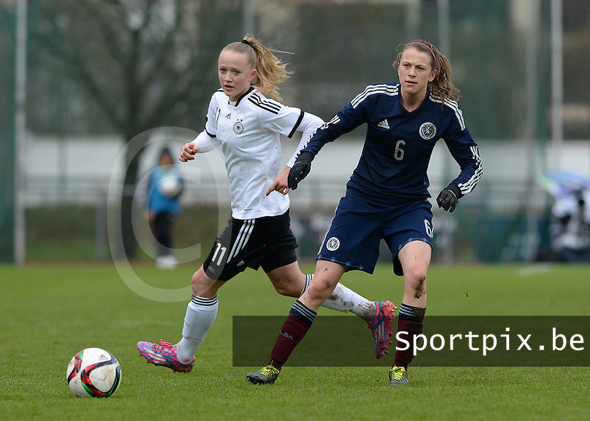 20150404 - FORST , GERMANY  : Scottish Elizabeth Arnot (6) pictured  with German Lea Schuller (left) during the soccer match between Women Under 19 teams of Germany and Scotland , on the first matchday in group 5 of the UEFA Elite Round Women Under 19 at WaldseeStadion , Forst , Germany . Saturday 4th April 2015 . PHOTO DAVID CATRY